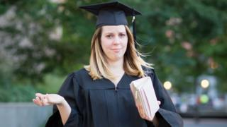 Graduate showing empty purse