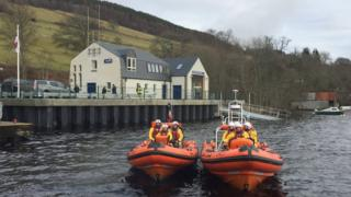 New Loch Ness lifeboat, right, alongside the craft it has replaced and with the new station in the background