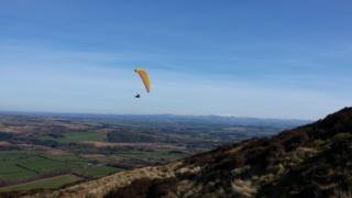 Paraglider over the Eildon Hills