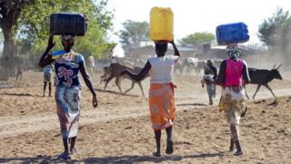 Women carry water in drought-stricken Mozambique