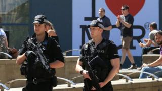 Armed police patrolling in Manchester