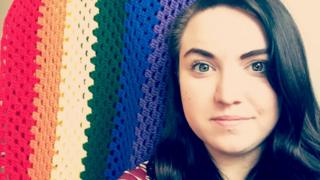 Rachel Hobbs Denton and her rainbow quilt