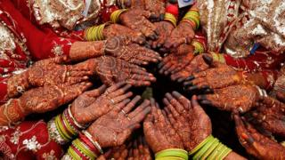 Brides at a mass wedding in Ahmedabad, India