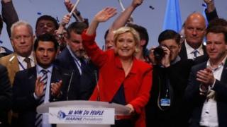 Marine Le Pen (centre) campaigns in Paris. Photo: 17 April 2017
