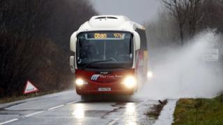 Bus going through flood