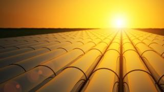 Oil pipelines in sunset