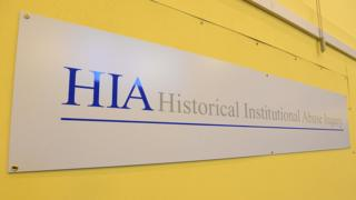 A sign that reads: Historical Institutional Abuse Inquiry