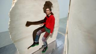 """French artist Abraham Poincheval poses inside his artwork Pierre (""""Stone"""") in Paris, France, on 22 February 2017, before entering the rock as part of his project to live inside for a week"""