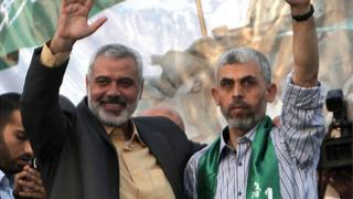 Yehiya Sinwar (right) and Ismail Haniyeh (left)