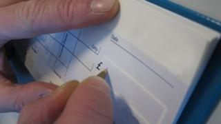 Cheque being written, stock image