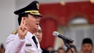 Basuki Tjahaja Purnama, also known as Ahok, gestures as he is sworn-in as Jakarta's new governor at the Palace in Jakarta on November 19, 2014.