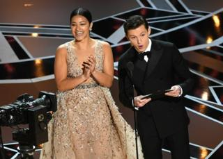 Gina Rodriguez and Tom Holland onstage
