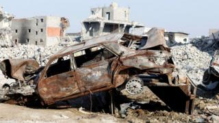 Remains of a car and buildings in the town of Awamiya, Saudi Arabia (9 August 2017)