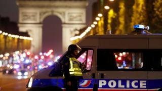 Police secure the Champs Elysee Avenue after one policeman was killed and another wounded in a shooting incident in Paris, France, 20 April