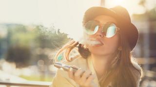 Woman smoking an e-cigarette