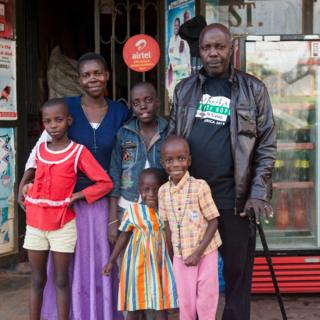 Mpagi with his wife and four young children