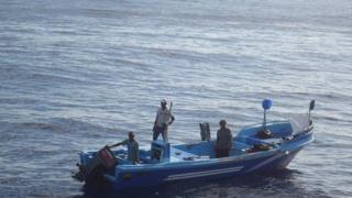 Four fishermen on a boat adrift in the Pacific off the coast off Chiapas