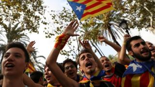 Protesters shout slogans and wave Esteladas (Catalan separatist flags) as they gather outside the High Court of Justice of Catalonia in Barcelona, Spain, 21 September 2017