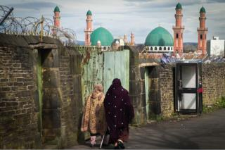 Women walk towards mosque in Bradford