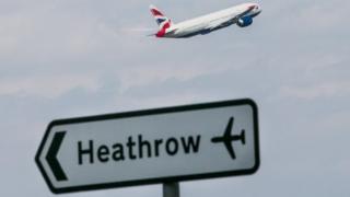 A Heathrow sign and an aeroplane