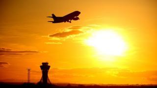 Plane taking off as summer holidays begin