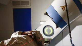A patient lies on their back in a radiotherapy machine in Khartoum.