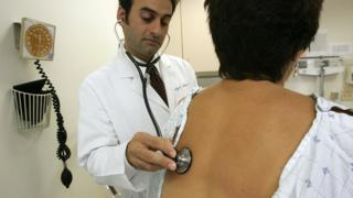 A doctor examines a patient in San Francisco, California