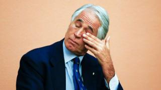 Italy's Olympic Committee chief Giovanni Malago wipes his tears at the end of his speech