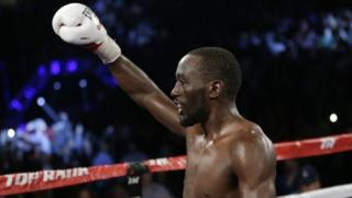 Crawford celebrates after defeating Molina in Omaha on 10 December