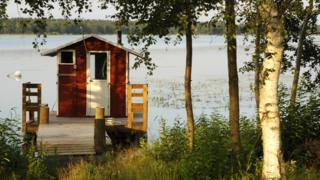 A Finnish sauna hut on a lake