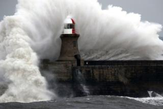 Giant waves crash over Souter Lighthouse in South Shields in Tynemouth