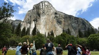 Image shows the El Capitan rock formation from ground level
