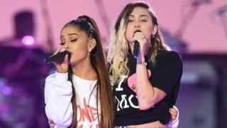 Ariana Grande (left) performed with Miley Cyrus