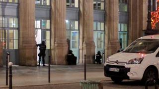 Police officers are seen at an entrance of the Paris Gare du Nord in Paris
