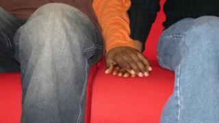Two men holding hands - generic shot
