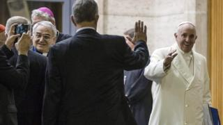 Pope Francis leaves a session of the synod in the Vatican