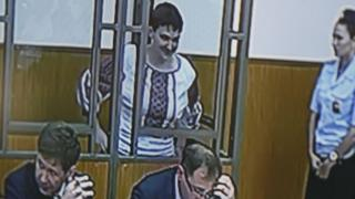 A monitor at a court's press room shows Ukrainian air force helicopter pilot Nadia Savchenko (22 September 2015)