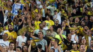 Aficionados en un estadio