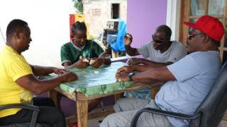 Barbudans playing dominoes