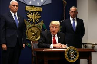 Donald Trump signs an executive order to impose tighter vetting of travellers entering the United States on January 27, 2017.