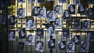 VIew of photos of killed journalists stuck on the fence of the Veracruz state representation office during a journalists protest in Mexico City on 11 February, 2016