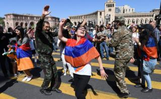 Supporters of Armenian opposition leader Nikol Pashinyan dance at the central square of Yerevan on May 2, 2018