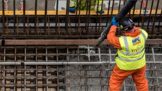 Worker pouring concrete at Hinkley C