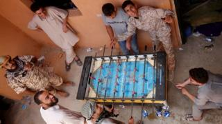 Libyan forces allied with the UN-backed government play table football at the frontline in the western part of Sirte - Tuesday 19 July 2016