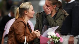 People at scene of tributes in Birstall