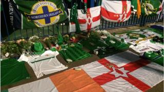 Republic of Ireland and Northern Ireland jerseys and flags mark the stop where Darren Rodgers lost his life