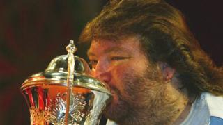 Andy Fordham kisses the trophy after winning The BDO Lakeside World Darts Championships in January 2004