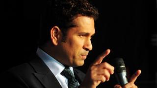 Sachin Tendulkar gestures at an event