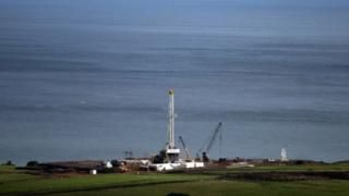 An oil exploration tower is pictured in Tonya on the shore of Lake Albert, Uganda. File photo