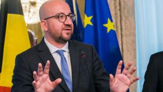 Belgium's Prime Minister Charles Michel gestures as he speaks during a press conference following an emergency meeting of all Belgium federal entities on the EU-Canada Comprehensive Economic and Trade Agreement (CETA) in Brussels on 24 October 2016.